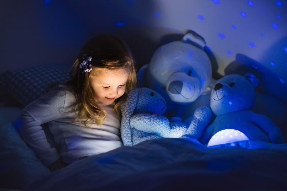 child reading by night light