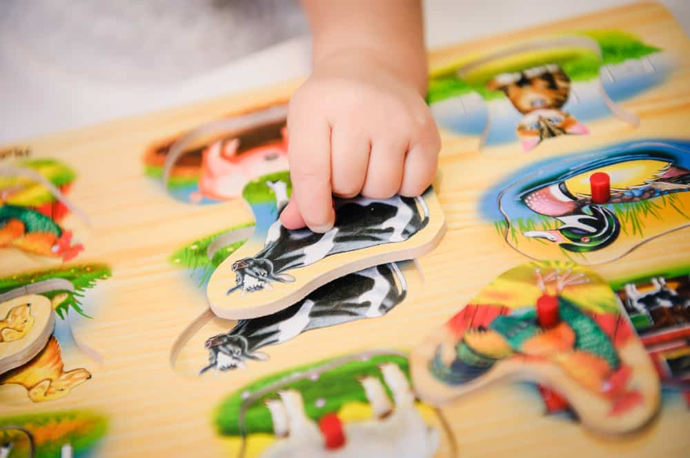 Child matching shapes on an activity table