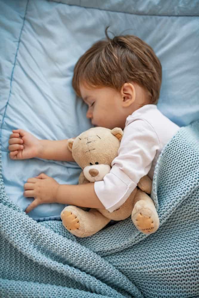 Child sleeping in a nap mat