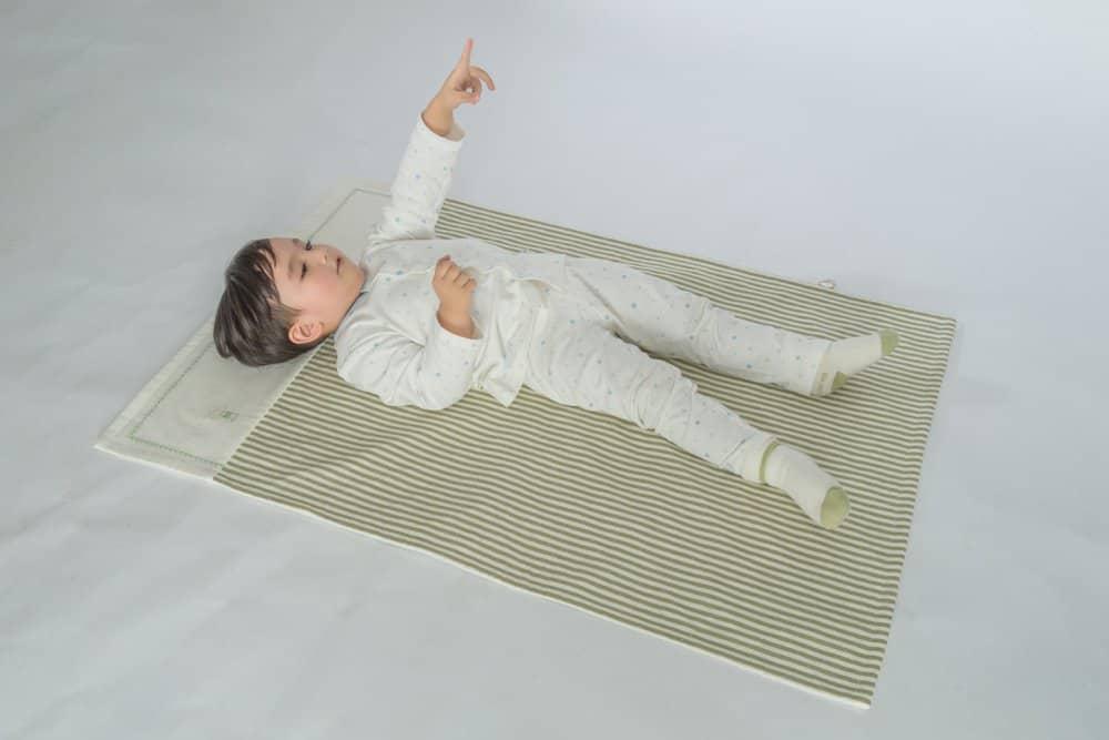 Toddler resting on a nap mat