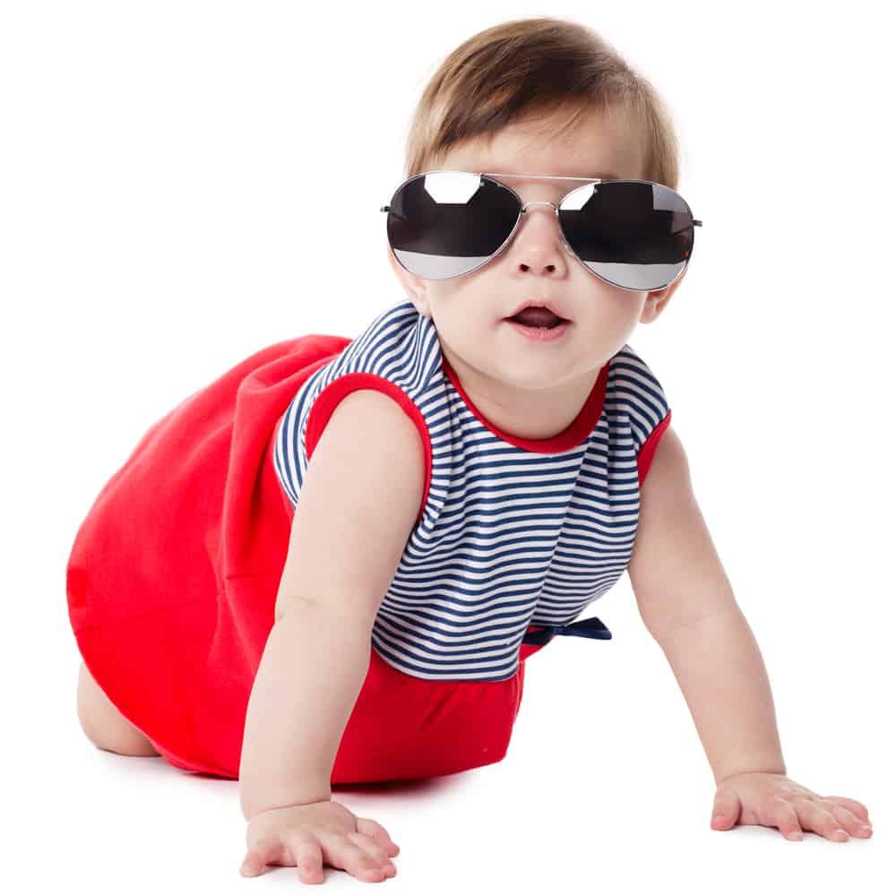 baby girl in oversized aviator sunglasses