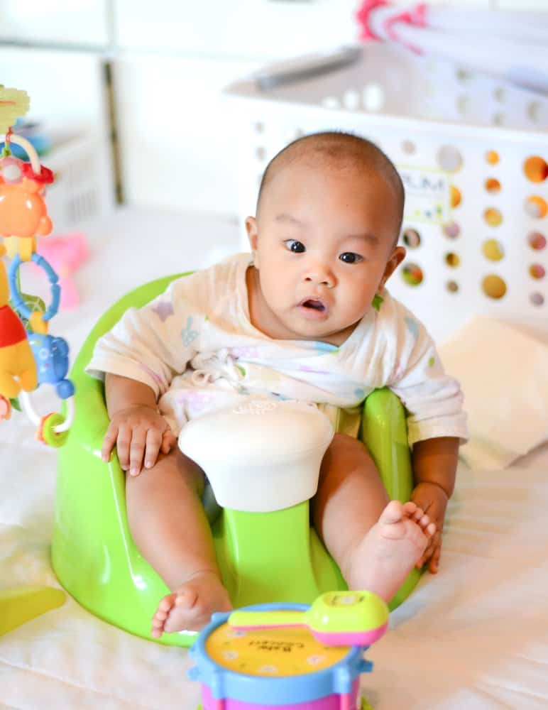 baby sitting on a baby floor seat