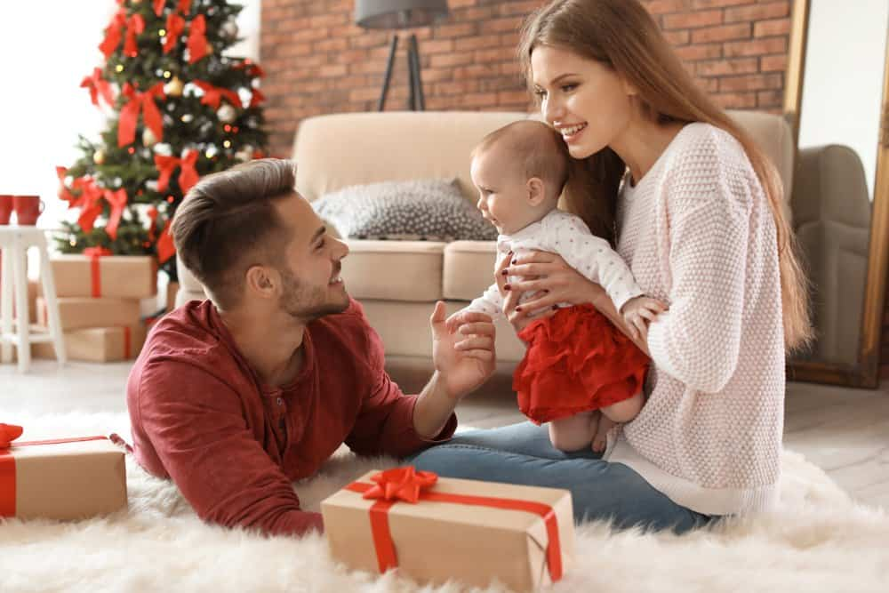 couple celebrating Christmas with baby