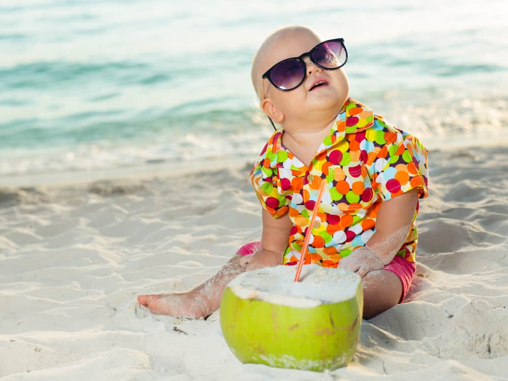 funny baby wearing sunglasses coconut