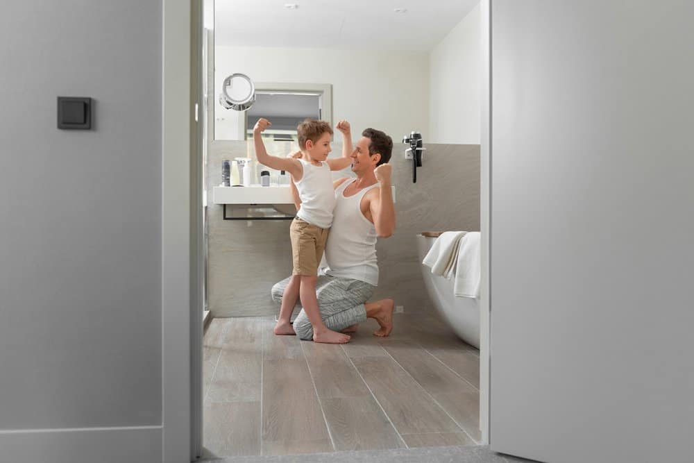 young boy and father celebrating in bathroom