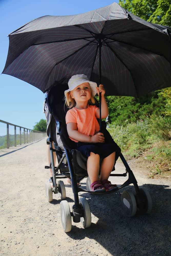 little girl sitting in stroller