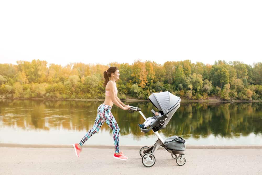 mother jogging with jogging stroller