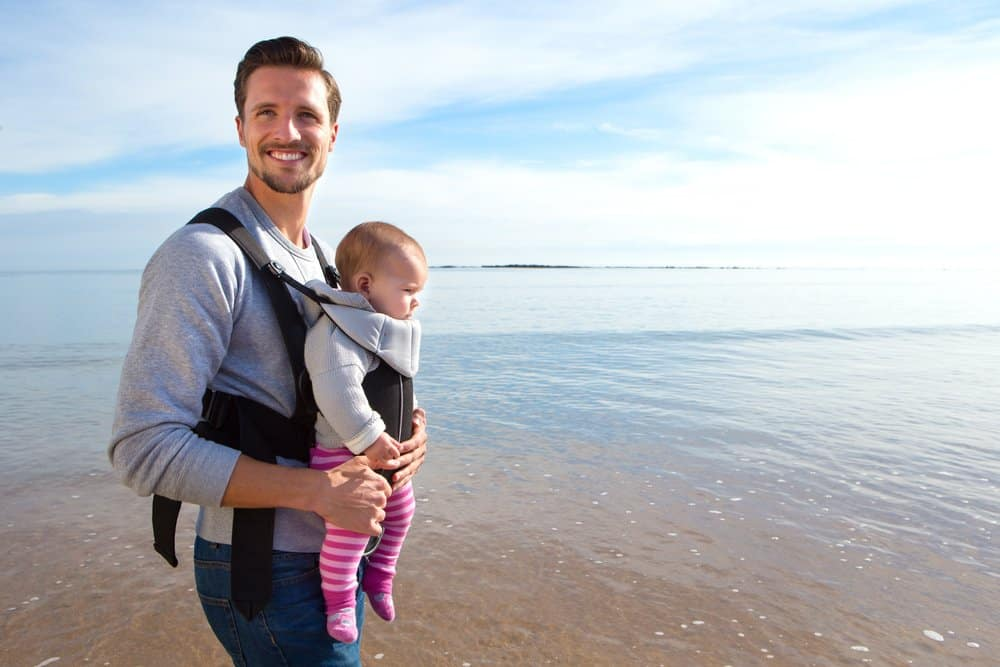 father using baby carrier