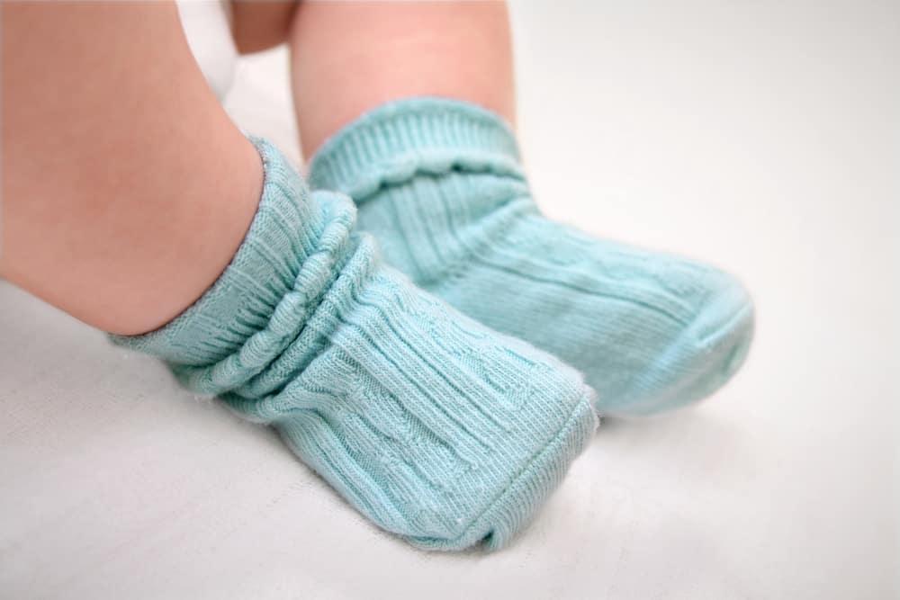 Baby wearing blue socks