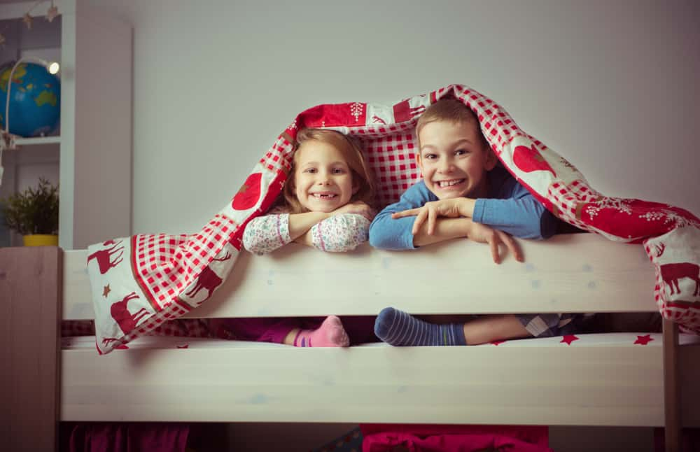 happy kids on the top bunk
