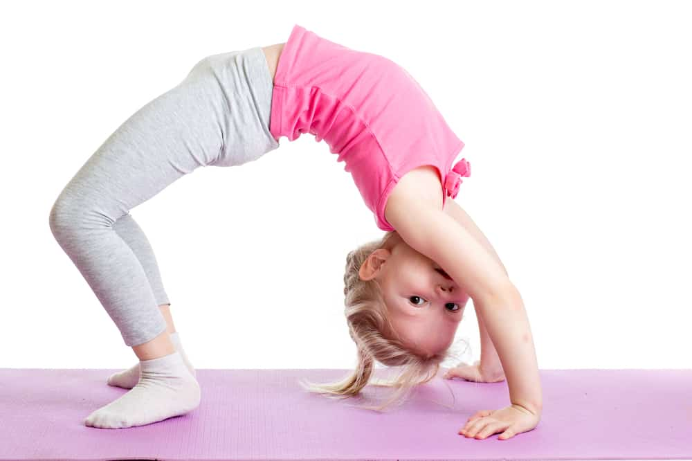 young girl doing back stretch