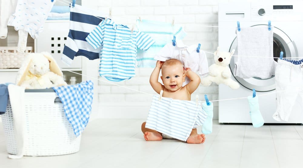 cute baby boy in laundry room