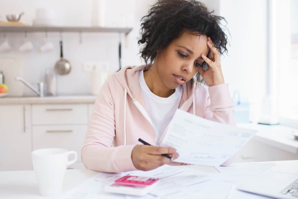 woman stressed with papers